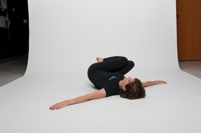Supine roll knees over hips 3
