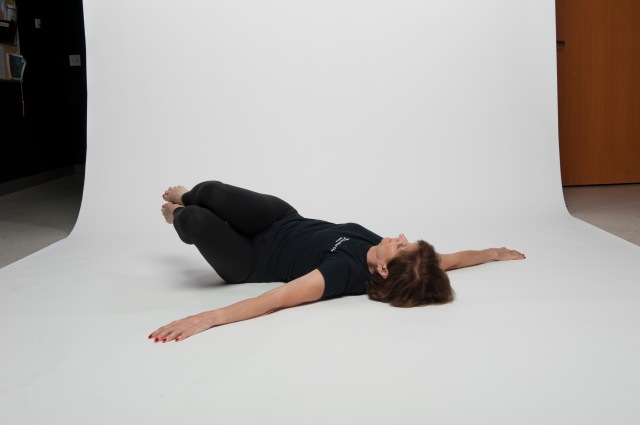 Supine roll knees over hips 5